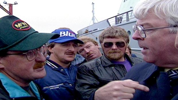 Then federal fisheries minister John Crosbie confronts fishermen in Bay Bulls on July 1, 1992.