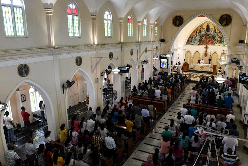Sri Lankan Catholic attend mass at St. Theresa's in Colombo as Catholic churches held services again (AFP Photo/LAKRUWAN WANNIARACHCHI)