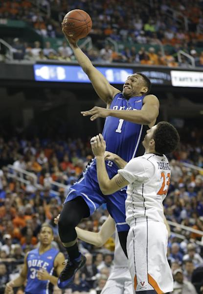 FILE - In this March 16, 2014 file photo, Duke's Jabari Parker (1) drives past Virginia's London Perrantes (23) during the second half of an NCAA college basketball game in the championship of the Atlantic Coast Conference tournament in Greensboro, N.C. Parker is entering the NBA draft, and there's a strong chance he'll be the No. 1 pick. (AP Photo/Gerry Broome, File)
