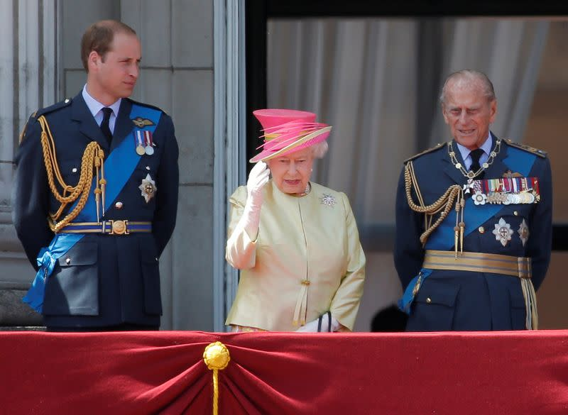 FILE PHOTO: Britain's Queen Elizabeth waves as she stands with Prince William and Prince Philip as as they prepare to view a RAF flypast to mark the 75th anniversary of the Battle of Britain