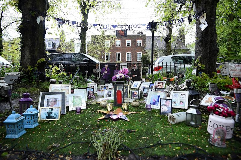 Tributes to George Michael outside his house in Highgate, north London. George Michael's family have asked fans to remove their tributes from outside the late singer's former homes for the sake of his neighbours.