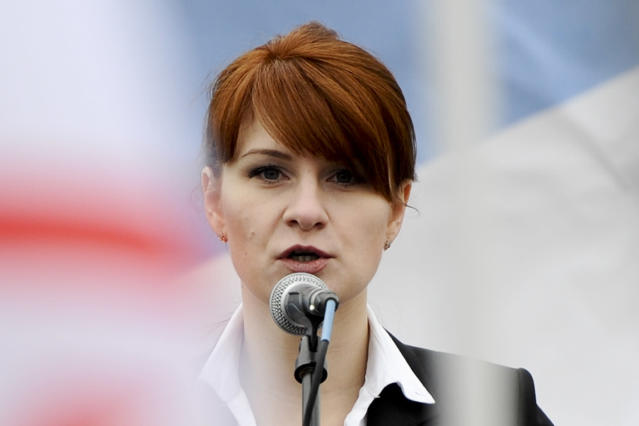 """FILE - In this April 21, 2013 file photo, Maria Butina, leader of a pro-gun organization in Russia, speaks to a crowd during a rally in support of legalizing the possession of handguns in Moscow, Russia. A new report by Oregon Sen. Ron Wyden, the top Democrat on the Senate Finance Committee, charges The National Rifle Association acted as a """"foreign asset"""" for Russia in the run-up to the 2016 election and NRA insiders provided access to the American political system to advance personal business interests. The report also said NRA leaders may have violated tax laws that prohibit use of organization resources for personal benefit. The report, based on an 18-month investigation by the finance panel's Democratic staff, found that NRA leaders """"engaged in a years-long effort to facilitate the U.S.-based activities"""" of Russian nationals Maria Butina and Alexander Torshin. (AP Photo/File)"""
