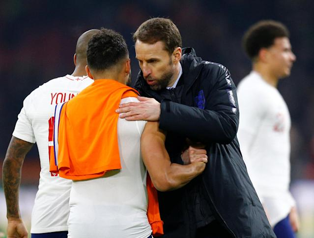 Soccer Football - International Friendly - Netherlands vs England - Johan Cruijff Arena, Amsterdam, Netherlands - March 23, 2018 England manager Gareth Southgate and England's Alex Oxlade-Chamberlain after the match REUTERS/Michael Kooren