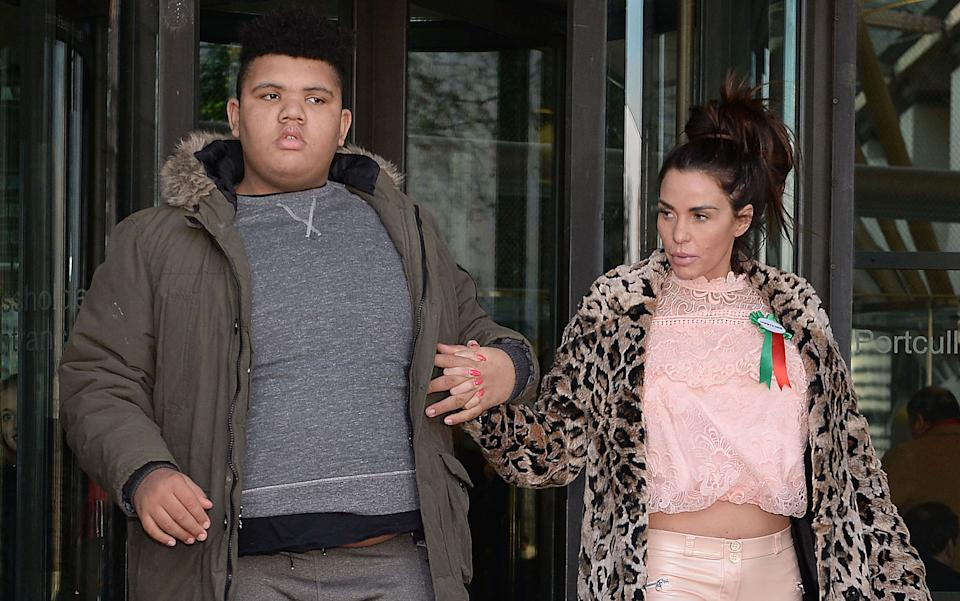 Katie Price with her son Harvey leaves Portcullis House in London after giving evidence to the Commons Petitions Committee where she called for online abuse to be made a specific offence. (Photo by Nick Ansell/PA Images via Getty Images)