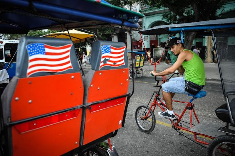 US flags adorn a pedicab in Havana on January 26, 2015 (AFP Photo/Yamil Lage)