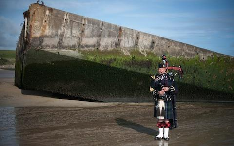 Lone Piper Major Trevor Macey-Lillie 19th Regiment RA (The Scottish Gunners) rehearses at the Mulberry Harbour - Credit: Eddie Mulholland