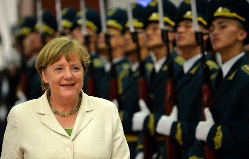 Like new British Prime Minister Theresa May, German Chancellor Angela Merkel's rise also came after years lying in wait until the time was ripe to snatch the crown (AFP Photo/Vyacheslav Oseledko)