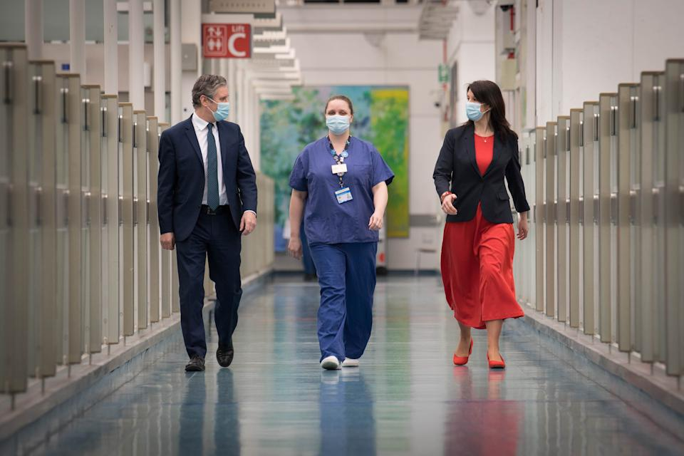 Labour party leader Sir Keir Starmer and Shadow Chancellor of the Duchy of Lancaster, Rachel Reeves chat with nurse Lisa Newell during a visit to Chelsea and Westminster Hospital, London, to thank the NHS staff for their work as the country marks the one year anniversary of the first national lockdown to prevent the spread of coronavirus. Picture date: Tuesday March 23, 2021.
