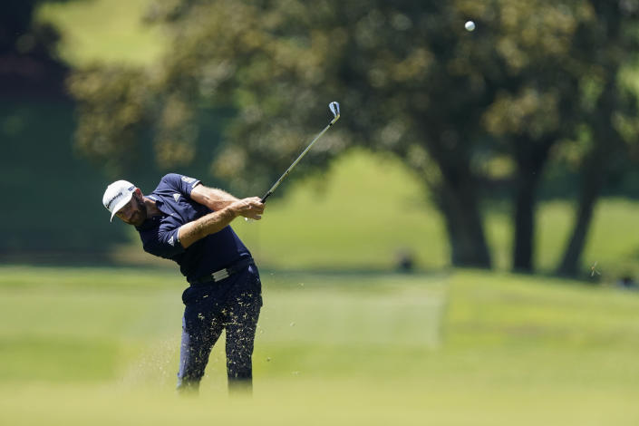 Dustin Johnson hits from the fairway on the fourth hole during the final round of the Tour Championship golf tournament at East Lake Golf Club in Atlanta, Monday, Sept. 7, 2020. (AP Photo/John Bazemore)