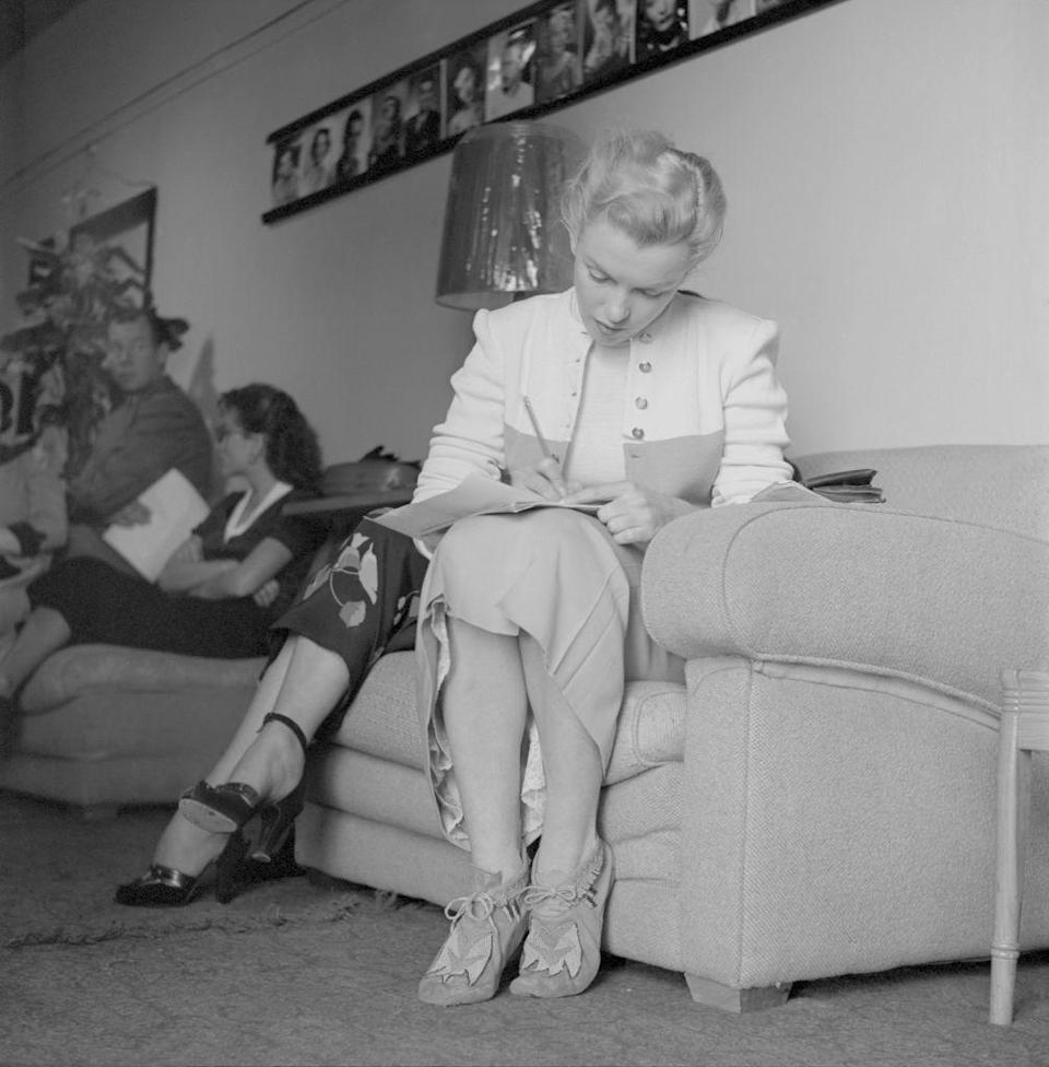 """<p>Marilyn always wanted to be taken seriously as an actress. Here, she's at an audition for a play. This same year, she received attention for her small role in John Huston's crime drama, <a href=""""https://www.amazon.com/Asphalt-Jungle-Sterling-Hayden/dp/B000SQXNGY/ref=sr_1_1?keywords=the+asphalt+jungle&qid=1562963016&s=gateway&sr=8-1&tag=syn-yahoo-20&ascsubtag=%5Bartid%7C10050.g.28612852%5Bsrc%7Cyahoo-us"""" rel=""""nofollow noopener"""" target=""""_blank"""" data-ylk=""""slk:The Asphalt Jungle"""" class=""""link rapid-noclick-resp""""><em><u>The </u></em><u><em>Asphalt Jungle</em></u></a> and also impressed audiences and critics when she appeared in <a href=""""https://www.amazon.com/All-About-Eve-Bette-Davis/dp/B004LQIA10/ref=sr_1_1?keywords=all+about+eve&qid=1562951684&s=gateway&sr=8-1&tag=syn-yahoo-20&ascsubtag=%5Bartid%7C10050.g.28612852%5Bsrc%7Cyahoo-us"""" rel=""""nofollow noopener"""" target=""""_blank"""" data-ylk=""""slk:All About Eve"""" class=""""link rapid-noclick-resp""""><em>All About Eve</em></a>, with Bette Davis. </p>"""