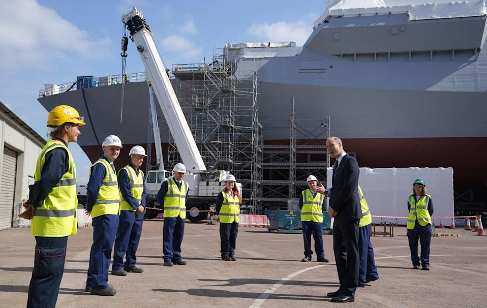 The Duke of Cambridge, known as the Earl of Strathearn in Scotland, chats to workers as they view construction work on HMS Glasgow (PA)