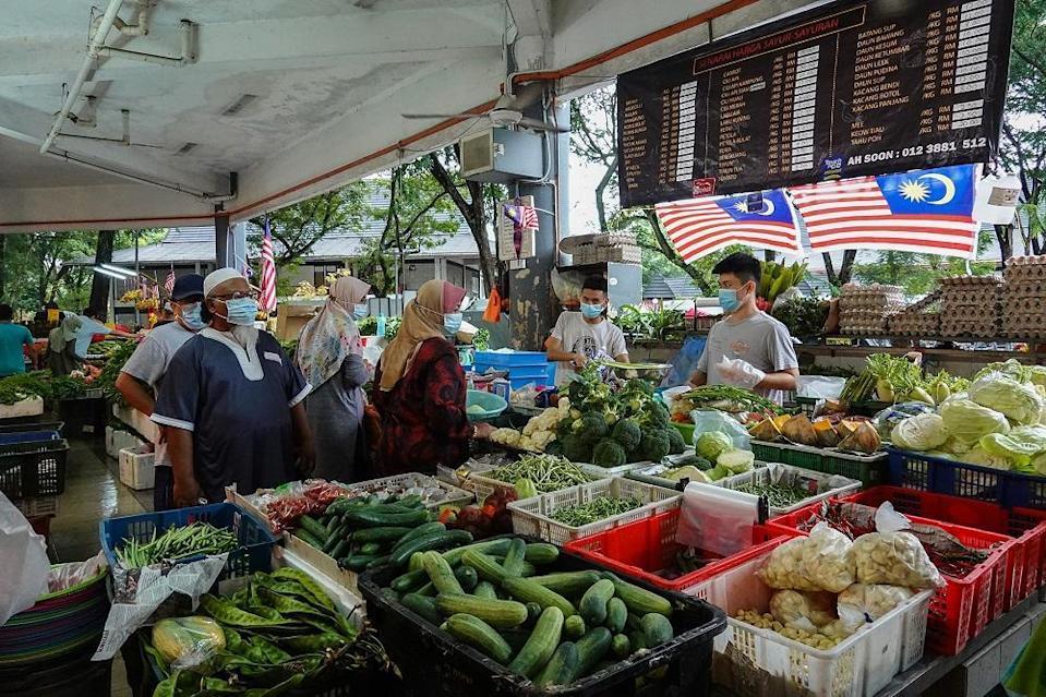 People shop for fresh produce at a morning market in Seksyen 6, Shah Alam October 3, 2020. ― Picture by Miera Zulyana