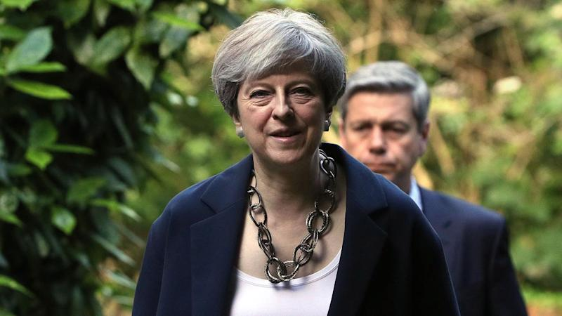 May returns foe in bid to unite party