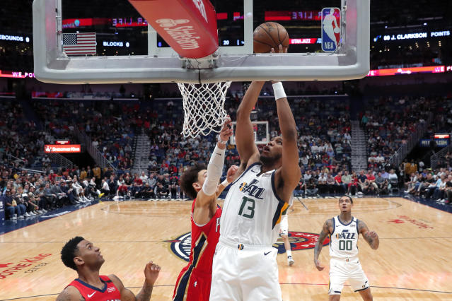 Utah Jazz center Tony Bradley (13) goes to the basket next to New Orleans Pelicans center Jaxson Hayes during the first half of an NBA basketball game in New Orleans, Thursday, Jan. 16, 2020. (AP Photo/Gerald Herbert)