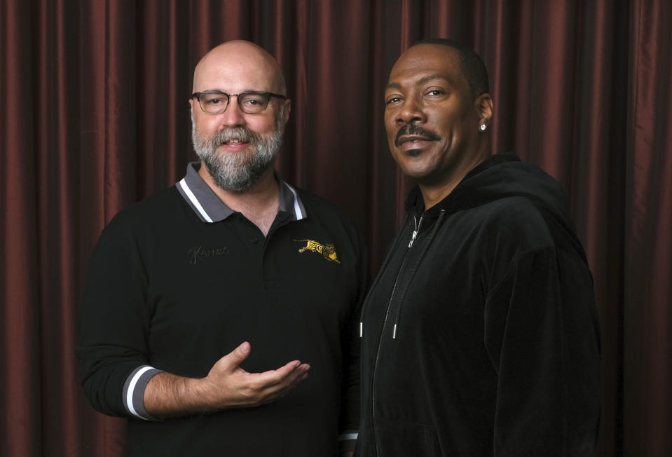 """FILE - This Sept. 7, 2019 file photo shows Eddie Murphy, right, star of the film """"Dolemite Is My Name,"""" with director Craig Brewer at the Shangri-La Hotel during the Toronto International Film Festival in Toronto. (Photo by Chris Pizzello/Invision/AP, File)"""