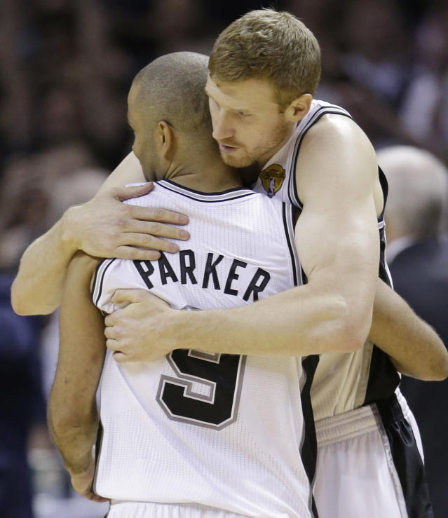San Antonio Spurs guard Tony Parker (9) and forward Matt Bonner celebrate in the final moments at Game 5 of the NBA basketball finals against the Miami Heat on Sunday, June 15, 2014, in San Antonio. The Spurs won the NBA championship 104-87. (AP Photo/David J. Phillip)