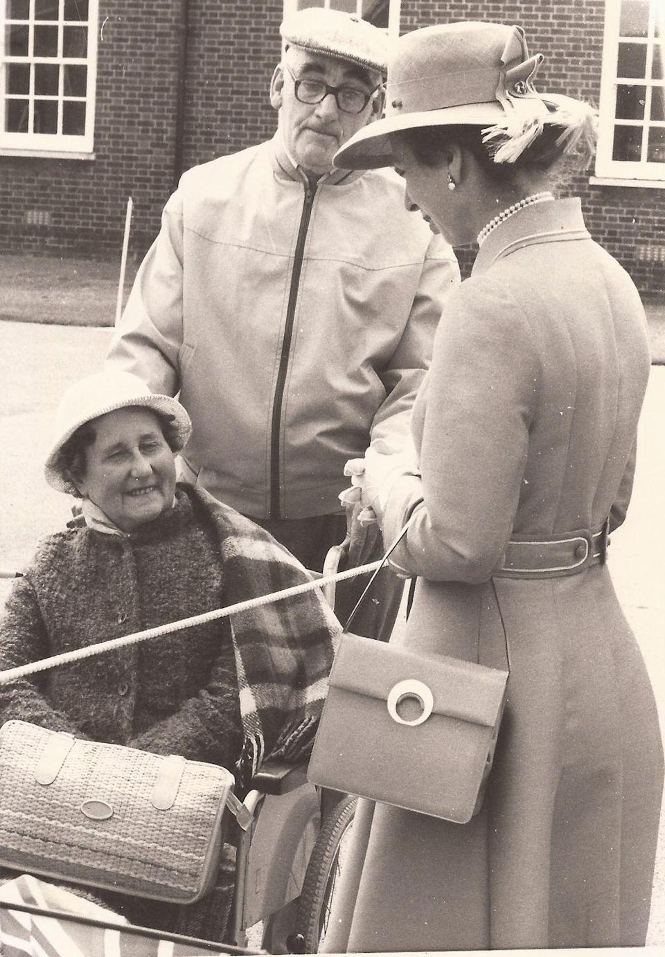 <p>The Queen's daughter speaking to photographer Jean Matthews' parents at RAF Waddington in June 1977.</p>