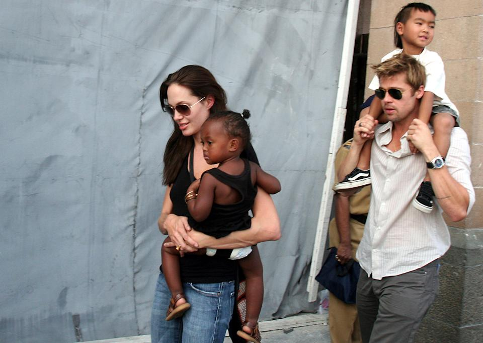 FILE - In this Nov. 12, 2006 file photo, American actress and UNHCR Ambassador Angelina Jolie, left, with her daughter Zahara, and Brad Pitt, right, with Jolie's son Maddox, walk near the Gateway of India in Mumbai, India. Angelina Jolie Pitt has filed for divorce from Brad Pitt, bringing an end to one of the world's most star-studded, tabloid-generating romances. An attorney for Jolie Pitt, Robert Offer, said Tuesday, Sept. 20, 2016, that she has filed for the dissolution of the marriage. (AP Photo, File)