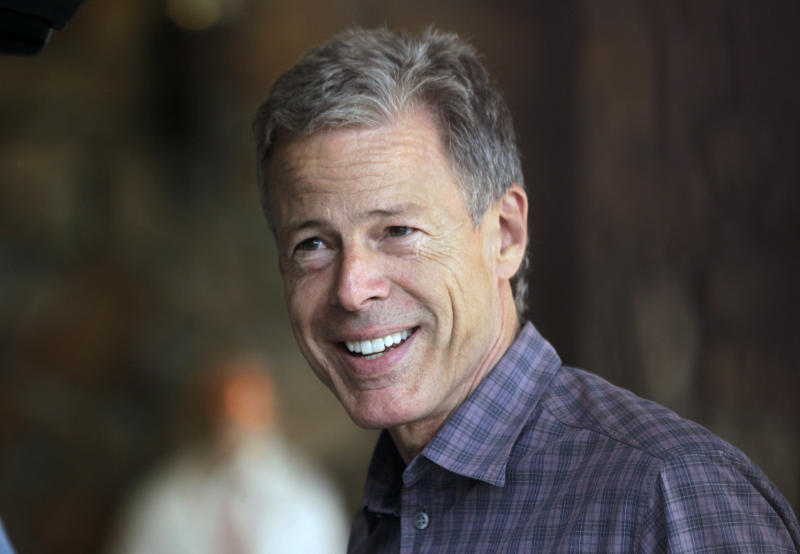 Time Warner 4Q earnings up, raises dividend 11 pct