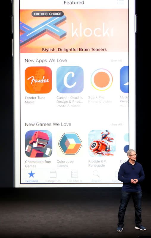 FILE PHOTO: Apple's CEO, Cook, discusses the App Store during an Apple media event in San Francisco