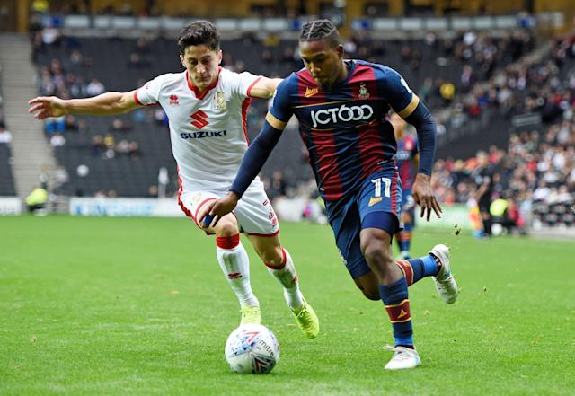 "Soccer Football - League One - Milton Keynes Dons vs Bradford City - Stadium MK, Milton Keynes, Britain - October 7, 2017 Bradford's Dominic Poleon in action with MK Dons' George Williams Action Images/Alan Walter EDITORIAL USE ONLY. No use with unauthorized audio, video, data, fixture lists, club/league logos or ""live"" services. Online in-match use limited to 75 images, no video emulation. No use in betting, games or single club/league/player publications. Please contact your account representative for further details."
