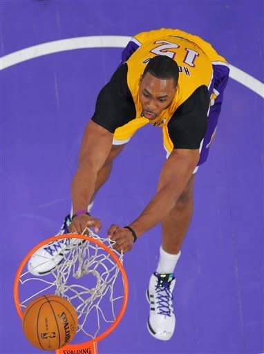 Los Angeles Lakers center Dwight Howard attempts to dunk during the first half of their NBA basketball game against the Portland Trail Blazers, Friday, Feb. 22, 2013, in Los Angeles. (AP Photo/Mark J. Terrill)