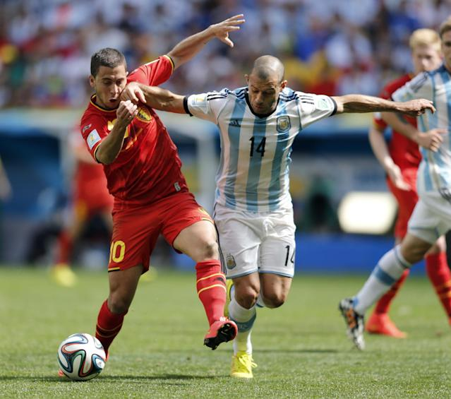 Argentina's Javier Mascherano right, fights for the ball with Belgium's Eden Hazard during the World Cup quarterfinal soccer match between Argentina and Belgium at the Estadio Nacional in Brasilia, Brazil, Saturday, July 5, 2014. (AP Photo/Eraldo Peres)