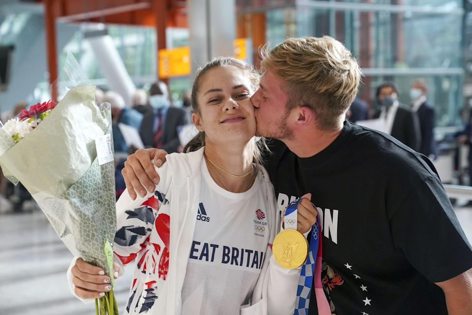 Gold medal winning BMX rider Bethany Shriever is met by her boyfriend Brynley Savage on her return to the UK (Steve Parsons/PA) (PA Wire)