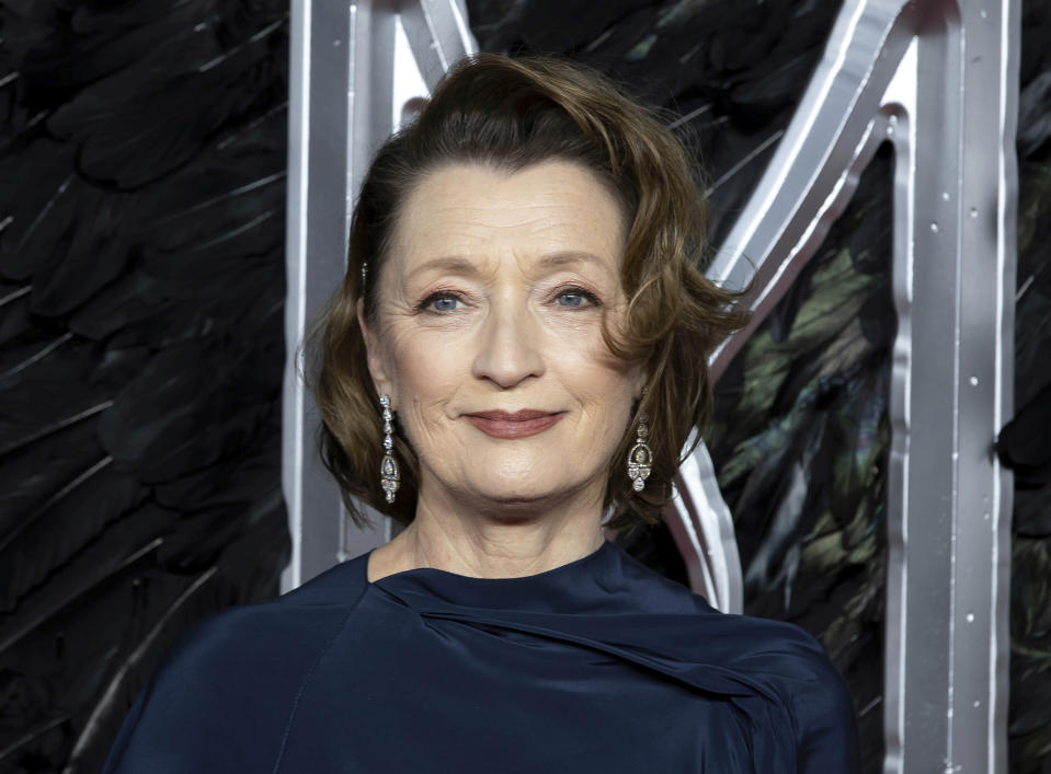 """FILE - In this Oct. 9, 2019 file photo, actress Lesley Manville appears at the premiere of the film """"Maleficent Mistress of Evil"""" in London. The Queen's New Year honors list was announced Wednesday, Dec. 30, 2020. Actress Lesley Manville, an Oscar nominee for """"Phantom Thread,"""" was named a Commander of the Order of the British Empire, or CBE. Actor Toby Jones, whose credits include Dobby in the """"Harry Potter"""" movies, was made an Officer of the Order of the British Empire or OBE, as was writer Jed Mercurio, creator of gripping TV detective series """"Line of Duty."""" (Photo by Grant Pollard/Invision/AP, File)"""