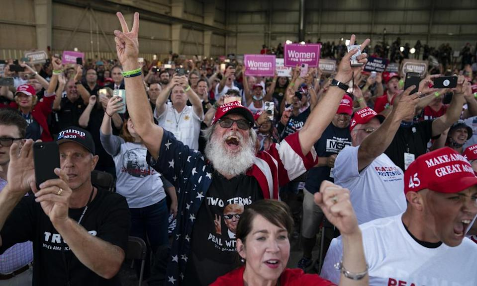 Supporters of Donald Trump cheer as he arrives to speak during a campaign rally at Arnold Palmer regional airport in Latrobe.