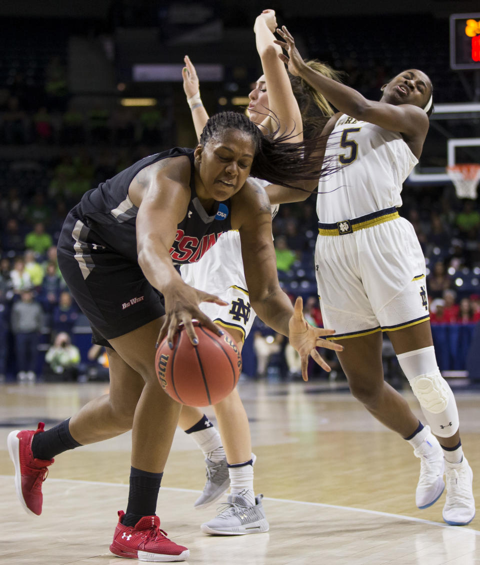 Cal State Northridge's ChannonFluker, left, grabs the ball in front of Notre Dame's Marina Mabrey and Jackie Young (5) during a first-round game in the NCAA women's college basketball tournament Friday, March 16, 2018, in South Bend, Ind. (AP Photo/Robert Franklin)