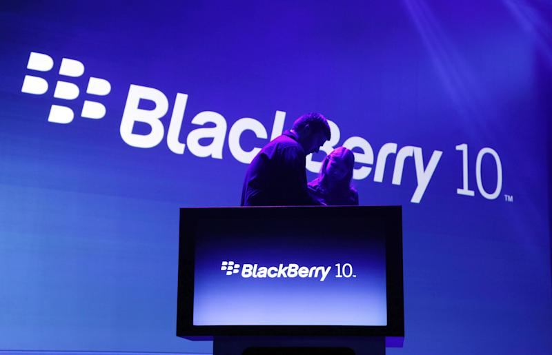 <p>               Stagehands prepare for the introduction of the BlackBerry 10, Wednesday, Jan. 30, 2013 in New York. The maker of the BlackBerry smartphone is promising a speedy browser, a superb typing experience and the ability to keep work and personal identities separate on the same phone, the fruit of a crucial, long-overdue makeover for the Canadian company. (AP Photo/Mark Lennihan)