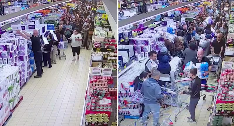 Aldi shoppers seen flooding the aisle.