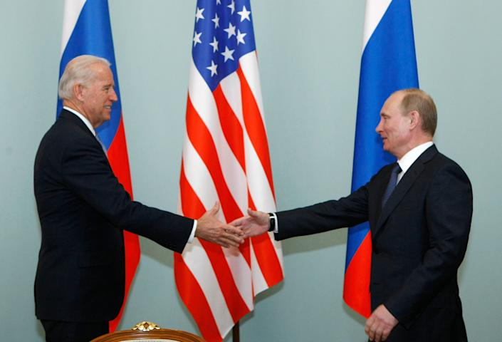 Then-Vice President Joe Biden shakes hands with Russian Prime Minister Vladimir Putin in Moscow, Russia on March 10, 2011.