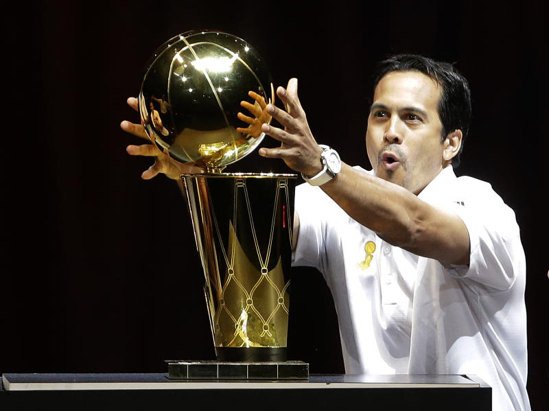 NBA champion Miami Heat head coach Erik Spoelstra touches the the Larry O'Brien NBA Championship trophy, Monday, June 24, 2013 during a celebration at the American Airlines Arena in Miami. (AP Photo/Wilfredo Lee)