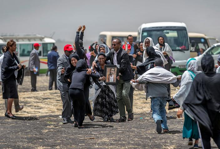 Ethiopian relatives of crash victims mourn at the scene where the Ethiopian Airlines Boeing 737 Max 8 crashed shortly after takeoff on Sunday killing all 157 on board, near Bishoftu, south-east of Addis Ababa, in Ethiopia, March 14, 2019. (Photo: Mulugeta Ayene/AP)