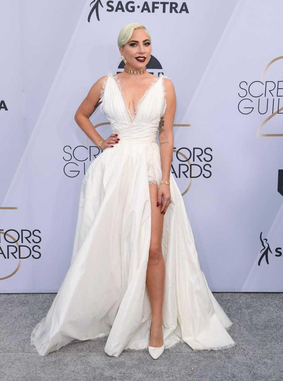 """<p>Lady Gaga's white Dior Couture look for the 2019 Screen Actors Guild Awards is fresh off the runway, as the gown <a rel=""""nofollow noopener"""" href=""""https://www.vogue.com/fashion-shows/spring-2019-couture/christian-dior"""" target=""""_blank"""" data-ylk=""""slk:debuted"""" class=""""link rapid-noclick-resp"""">debuted</a> at Paris Fashion Week mere days ago. Gaga, a nominee for Outstanding Performance by a Female Actor in <em>A Star Is Born,</em> is fresh from Las Vegas, where she and Bradley Cooper <a rel=""""nofollow noopener"""" href=""""https://www.vogue.com/fashion-shows/spring-2019-couture/christian-dior"""" target=""""_blank"""" data-ylk=""""slk:performed"""" class=""""link rapid-noclick-resp"""">performed</a> """"Shallow"""" live for the first time since the film's release. (Photo: Getty Images) </p>"""