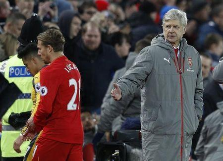 Arsenal manager Arsene Wenger, Arsenal's Alexis Sanchez and Liverpool's Lucas Leiva after the match