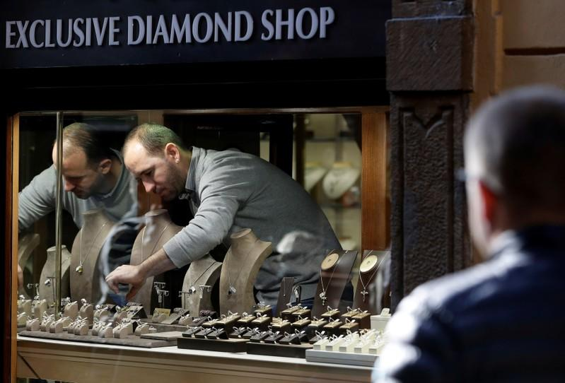 A vendor arranges accessories on display at a jewellery shop in Prague