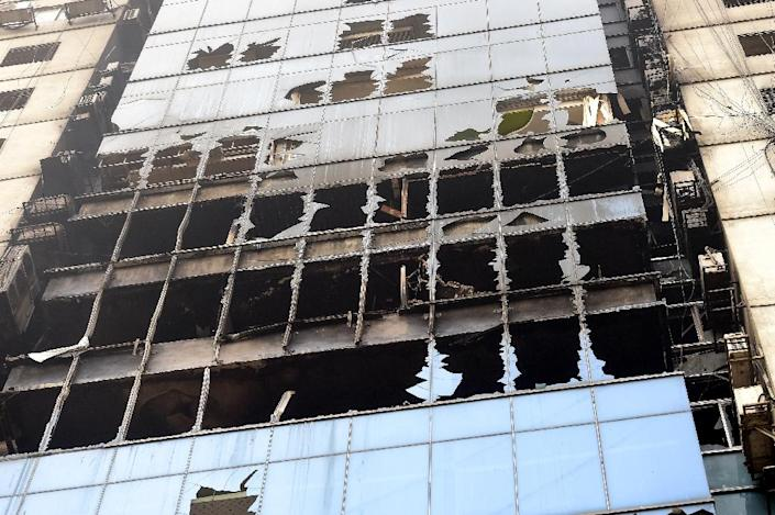 Fire fighters were hampered by not having ladder cranes big enough to reach the top floors, officials said (AFP Photo/MUNIR UZ ZAMAN)
