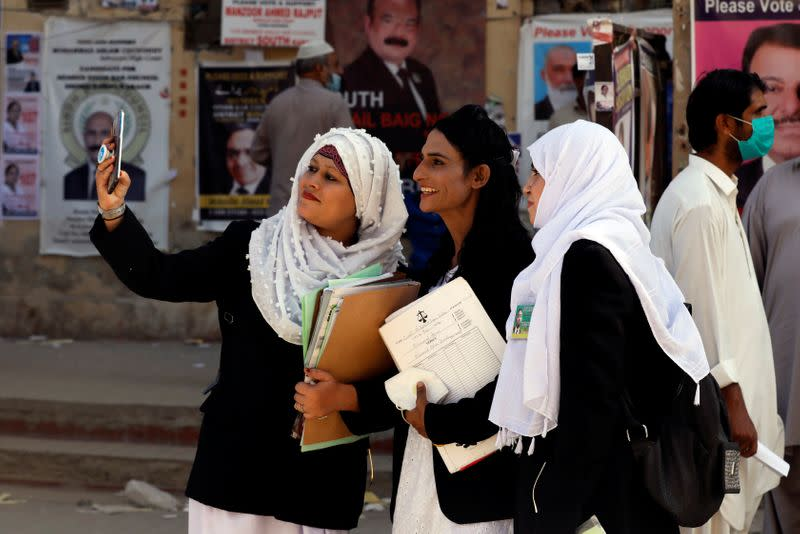 Nisha Rao, 28, a transgender woman who became country's first practicing lawyer, poses for a selfie along with her colleagues at the district City Court in Karachi