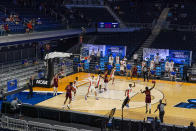 Florida plays against Virginia Tech in the first half of a first round game in the NCAA men's college basketball tournament at Hinkle Fieldhouse in Indianapolis, Friday, March 19, 2021. Restrictions due to the COVID-19 pandemic have limited crowds, reduced interactions and created an abnormal NCAA experience for those involved. (AP Photo/Michael Conroy)
