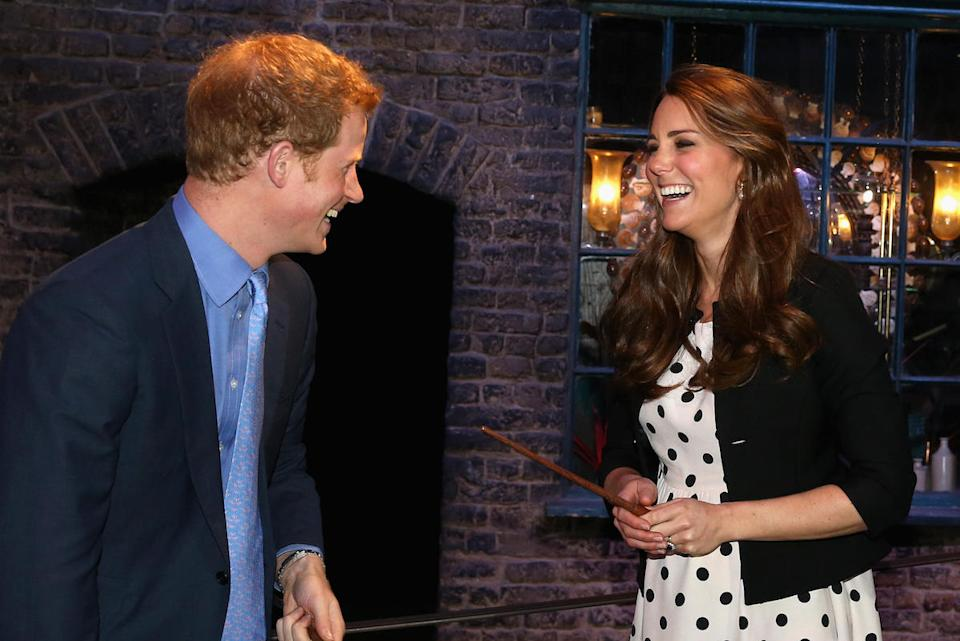 Catherine, Duchess of Cambridge and Prince Harry, attend the inauguration of Warner Bros. Studios in April 2013