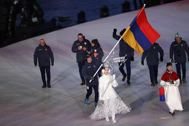 <p>Flag bearer Mikayel Mikayelyan of Armenia leads the team during the Opening Ceremony of the PyeongChang 2018 Winter Olympic Games at PyeongChang Olympic Stadium on February 9, 2018 in Pyeongchang-gun, South Korea. (Photo by Ronald Martinez/Getty Images) </p>