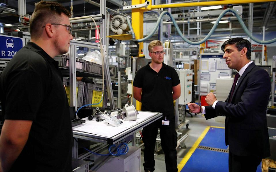 Chancellor of the Exchequer Rishi Sunak (R) speaks to employees during a visit to the Worcester Bosch factory in Worcester, central England, on July 9, 2020 - Phil Noble/AFP