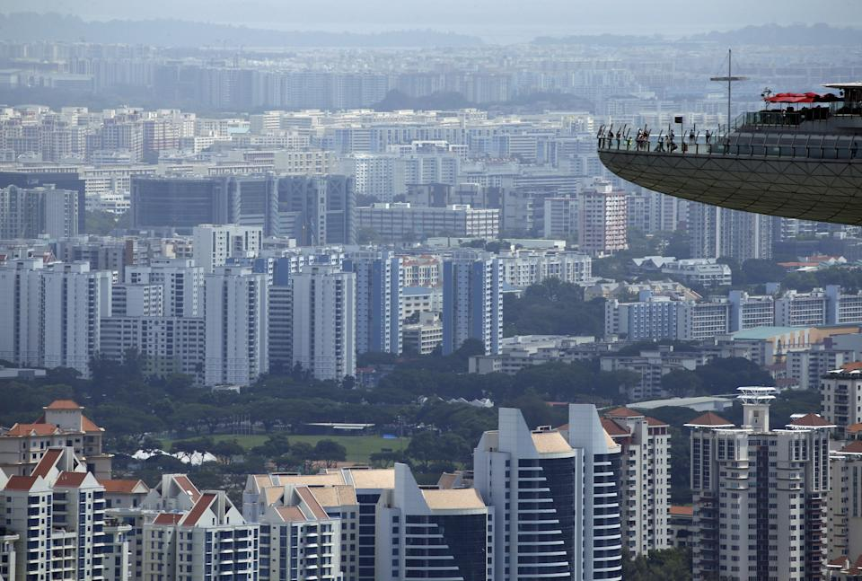 People look out from the observation tower of the Marina Bay Sands amongst public and private residential apartment buildings in Singapore, February 22, 2016. REUTERS/Edgar Su      TPX IMAGES OF THE DAY