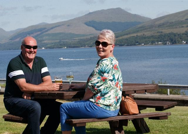 Caroline Hedley, 57, an auxiliary nurse at Hawick Community Hospital, enjoys the view with her husband David at the Loch Fyne Hotel and Spa in Inveraray, Argyll and Bute