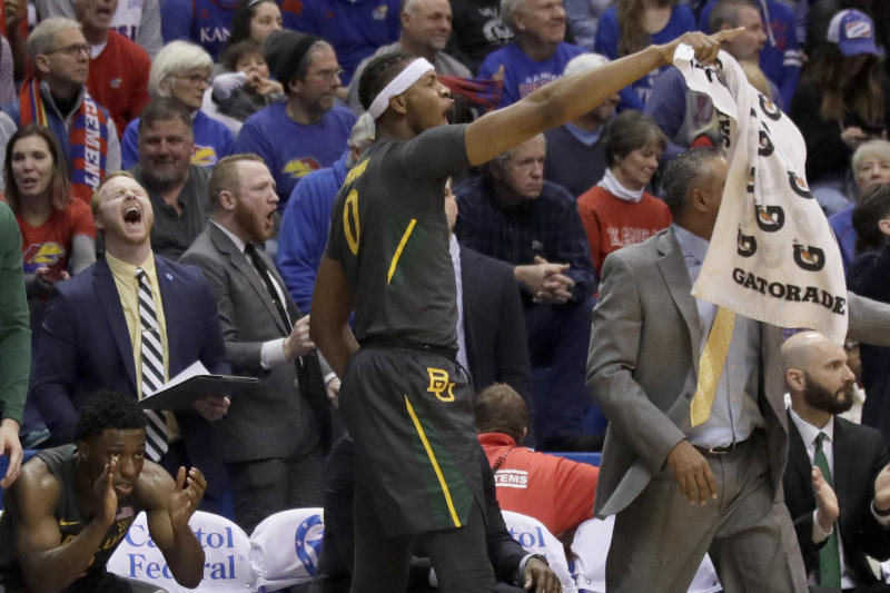 Baylor forward Flo Thamba (0) celebrates a basket from the bench during the second half of an NCAA college basketball game against Kansas in Lawrence, Kan., Saturday, Jan. 11, 2020. Baylor defeated Kansas 55-67. (AP Photo/Orlin Wagner)