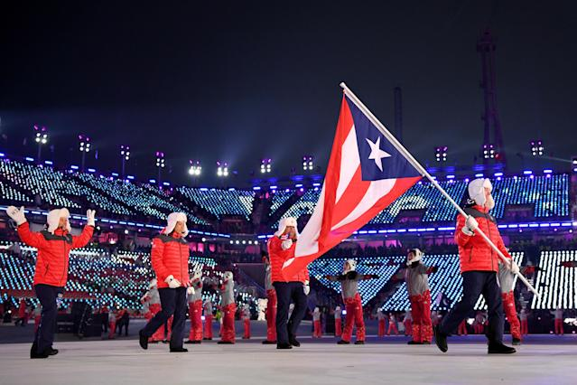 <p>Flag bearer Charles Flaherty of Puerto Rico and teammates arrive at the stadium during the Opening Ceremony of the PyeongChang 2018 Winter Olympic Games at PyeongChang Olympic Stadium on February 9, 2018 in Pyeongchang-gun, South Korea. (Photo by Matthias Hangst/Getty Images) </p>