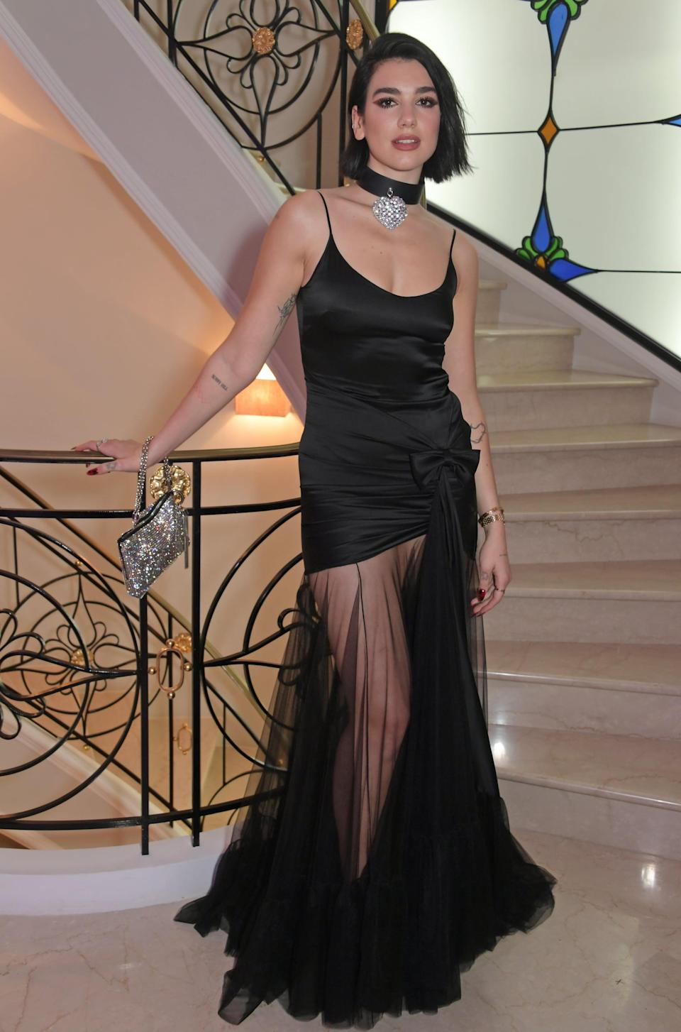 <p>Wearing a black minidress with a sheer skirt at the 2019 Cannes Film Festival.</p>